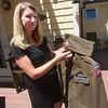 JIM VAIKNORAS/Staff photo Michelle Sanchez of Amesbury looks over her grandfather Stanley Kawa's World War 2 uniform.