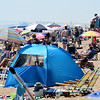 JIM VAIKNORAS/Staff photo People crowd Salisbury Beach Saturday morning on a hot June Saturday.
