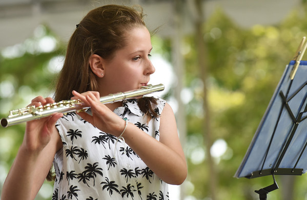 """BRYAN EATON/Staff photo. Lauren Konefal, 13, vacationing from Connecticut, plays """"Best Day of My LIfe"""" at the Yankee Homecoming Kids Talent Showcase."""