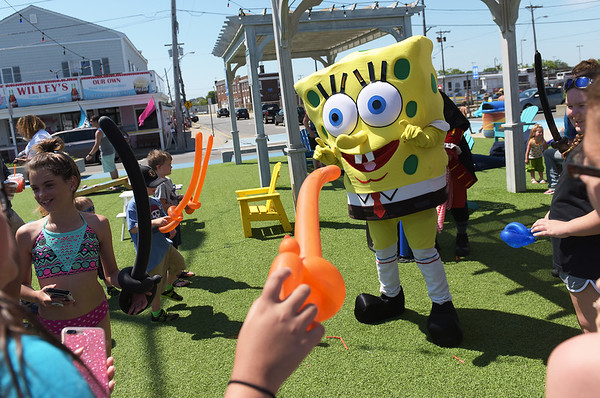 TIM JEAN/Staff photo<br /> <br />  Sponge Bob Square Pant and a pirate costume character entertain the crowd that gathered during Kids Day on the Broadway Mall at Salisbury Beach. Every Tuesday from starting at 10 am thru August 28th events will take place for children.         7/10/18