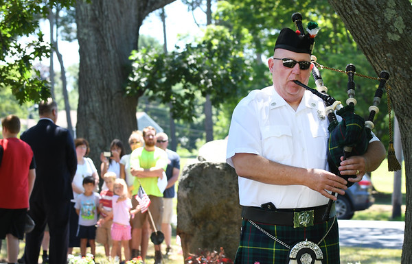 JIM VAIKNORAS/Staff photo Retired fire fighter Jim MacDonald plays Amazing Grace on the bagpipes at the   re-dedication of a marker in Newburyport Friday honoring Private Cornelius Doyle who was killed in France on July 20, 1918.