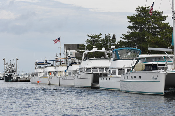 JIM VAIKNORAS/Staff photo Nine catamarans line the Newburyport waterfront Friday afternoon. The boas traveled up from Florida and are spending a few days in Newburyport.
