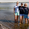 BRYAN EATON/Staff photo. Three local women from Newburyport will be participating in the Swim Across America event in Boston Harbor this weekend. They train and swim together in the water between Joppa and Plum Island regularly. From left, BlakeLee Greene, Elizabeth Brugger and Courtney Luck are members of Team Goldman and Friends, which is annually one of the most prolific fundraising groups in the entire city.