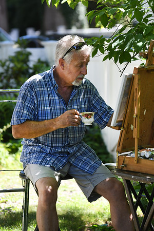 JIM VAIKNORAS/Staff photo Local artist Ron Quinn enjoys a cup of tea at the annual Tea at the Whittier Home and Museum  in Amesbury Saturday .