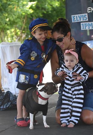 JIM VAIKNORAS/Staff photo Alyssa Shuto holds Stella Shuto-Quinn as Shane Nee holds Willis's leach during Yankee Homecoming's pet contest Sunday at the Bartlet Mall in Newburyport.