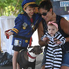 JIM VAIKNORAS/Staff photo Alyssa Shuto holds Stella Shuto-Quinn as Shane Nee holds Willis's leach during Yankee Homecoming's pet contest Sunday at the Bartlet Mall in Newburyport.