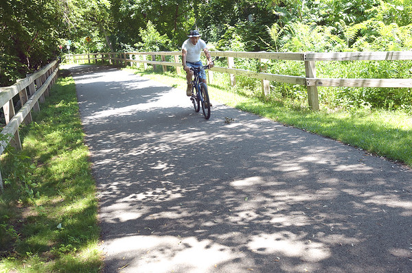 TIM JEAN/Staff photo  A cyclists makes his way along the Old Eastern Marsh Rail Trail in Salisbury. Work on connecting the Clipper City Trail in Newburport and the Ghost trail in Salisbury will soon begin. 7/9/18