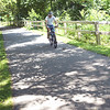 TIM JEAN/Staff photo<br /> <br /> A cyclists makes his way along the Old Eastern Marsh Rail Trail in Salisbury. Work on connecting the Clipper City Trail in Newburport and the Ghost trail in Salisbury will soon begin. 7/9/18