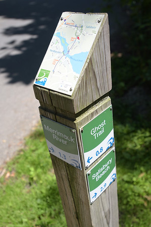 TIM JEAN/Staff photo<br /> <br /> A trail marker on the Old Eastern Marsh Rail Trail displays a map on it and marks the way toward the Ghost Trail in Salisbury. 7/9/18