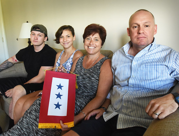 BRYAN EATON/Staff photo. The Bent family in Amesbury have three sons serving in the military including Jake, at left, with sister Katie, Jennifer and Gary. Also are sons Andrew and Michael Nizwantowski.