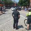 JIM VAIKNORAS/Staff photo Newburyport police keep a eye out as more than one hundred people in Market Square in Newburyport Saturday  protesting President Trump's immigration policies.