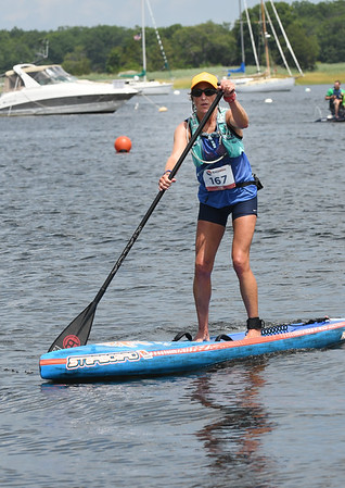 JIM VAIKNORAS/Staff photo Marielle Yost finishes on a stand up paddle board 3rd annual Yankee Homecoming Kayak and SUP River Race at Cashman Park in Newburyport Saturday.