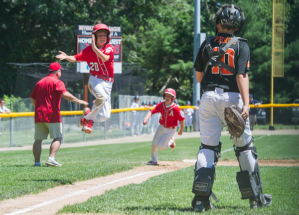 AMANDA SABGA/Staff photo<br /> <br /> Amesbury's Reece Jezowski (20) celebrates as he runs in the first of many runs on a home run during a game against Beverly at the Harry Ball Field in Beverly.<br /> <br /> 7/7/18