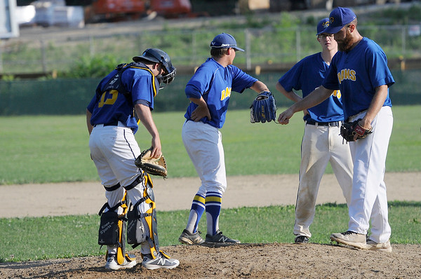 TIM JEAN/Staff photo<br /> <br /> Rowley Rams pitcher Jake Barresi, right, meets with a few teammates on the mound during a inning.  7/11/18