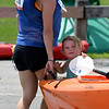 JIM VAIKNORAS/Staff photo Eldie Stafford of Newburyport helps her mom Rebekah carry her kayak after she finished the 3rd annual Yankee Homecoming Kayak and SUP River Race at Cashman Park in Newburyport Saturday.