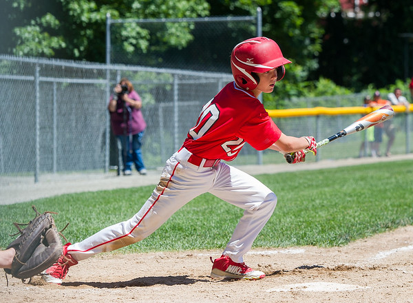 AMANDA SABGA/Staff photo<br /> <br /> Amesbury's Reece Jezowski (20) runs off f home base during a game against Beverly at the Harry Ball Field in Beverly.<br /> <br /> 7/7/18