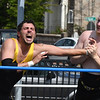 JIM VAIKNORAS/Staff photo Atlantic Pro Wrestler The Hired Gun gets The Wretling MAchine in a wrist hold during their match at Yankee Homecoming Old-Fashioned Sunday at the Bartlet Mall in Newburyport.