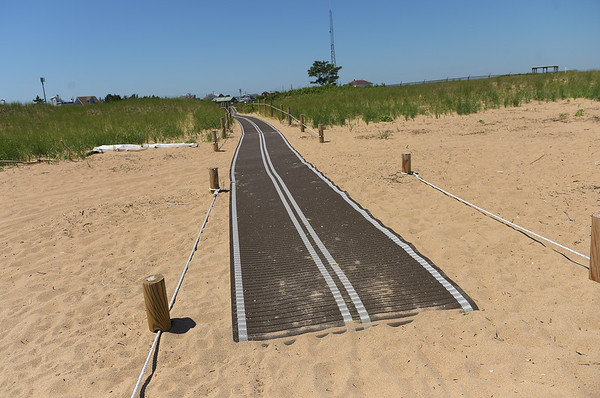 TIM JEAN/Staff photo<br /> <br /> Mobi-Mats recently placed on Plum Island beach access ways help with the dune erosion. The mats lead from the parking lot at Plum Island Point over the dunes into the beach. 7/10/18