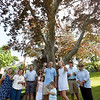 BRYAN EATON/Staff photo. Drew and Sarah Sansone, center, with children Logan, 6, and Leighton, 2, with neighbors toast two copper beech trees at their 51 High Street home which are being taken down Friday. The trees, more than 200 years old, have lost limbs over the years and are rotted and diseased.
