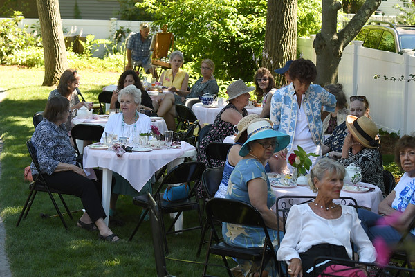 JIM VAIKNORAS/Staff photo Guest enjoy tea snack and fancy hats at the annual Tea at the Whittier Home and Museum in Amesbury Saturday .