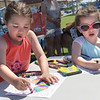 TIM JEAN/Staff photo<br /> <br /> Gianna Cutrona, 4, left, and Jayden Aziz, 5, both of Salisbury, enjoy coloring during Kids Day on the Broadway Mall at Salisbury Beach. Every Tuesday from starting at 10 am thru August 28th events will take place for children.         7/10/18