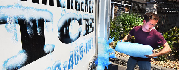 BRYAN EATON/Staff photo. Mitchell Merrill of Emergency Ice makes a delivery to Michael's Harborside in Newburyport on Thursday morning at the temperature returned to the 90's. Though many restaurants have their own ice-making machines, during the busy tourist season and hot weather of late, the ice company has been straight out said owner Sandy Tarr.