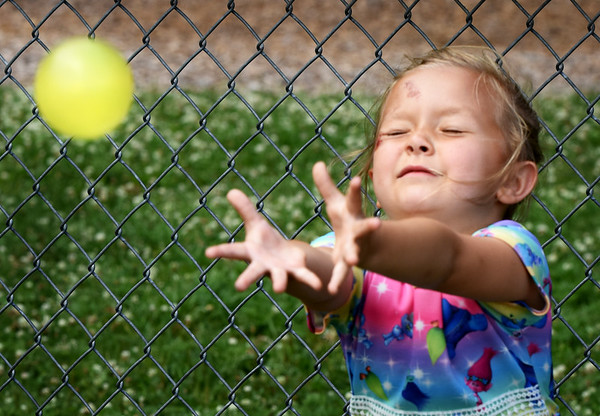 BRYAN EATON/Staff photo. Hands outstreched and eyes closed, Adriana Carabineras, 6, misses the water balloon which exploded on the ground at the Boys and Girls Club in Salisbury on Monday afternoon. The first and second-graders were also doing other water activities to cool down.