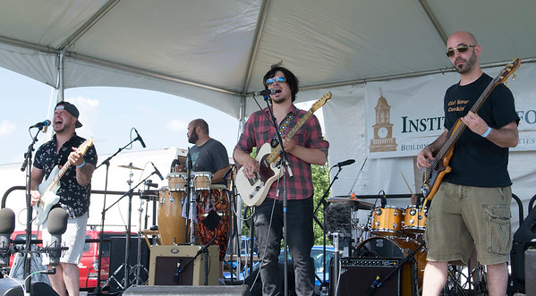 JIM VAIKNORAS/Staff photo Cold Engines perform  at the Fourth annual Byfield Music and Arts Festival at Manter Field in Byfield Saturday.