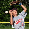 BRYAN EATON/Staff photo. Boxford's Hudson Weidman comes up short on a pop up as the sun got in his eyes.