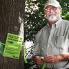 BRYAN EATON/Staff photo. Jeff Esche is warning about the emerald ash borer which is devastating to ash trees.