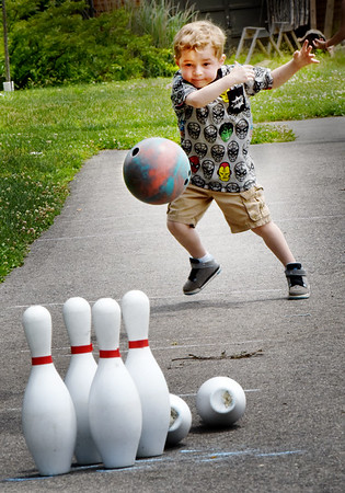 BRYAN EATON/Staff photo. Jace Bilodeau, 3, of Amesbury has some spectacular moves as he bowls his second ball at Amesbury Days' Kids Day in the Park. His mom, Kaleigh, says the youngster loves to go bowling, though he plays candlepin at Riverwalk Lanes.