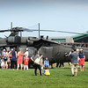 BRYAN EATON/Staff photo. People check out the Blackhawk helicopter on the ball field at Cashman Park in Newburyport before the start of the Derek Hines 5K Roadrace.