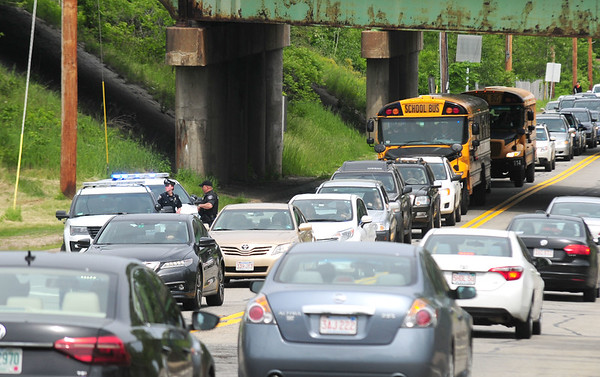 JIM VAIKNORAS/staff photo Amesbury Police block entrance to the Macy Street on-ramp to Rt 495 in Amesbury Friday afternoon.The ramp was closed due to a roll over.