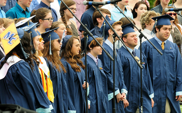 JIM VAIKNORAS/staff photo Triton graduating seniors perform with the Triton High School Singers at commencement exercises in Byfield Saturday.