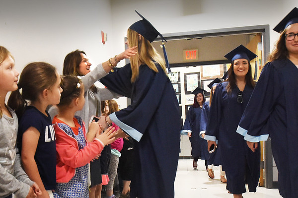 BRYAN EATON/Staff photo. Soon-to-be Triton High graduate Katie Morrison hugs kindergarten teacher Jane Keeler, who she had as a preschool teacher, at Salisbury Elementary School.