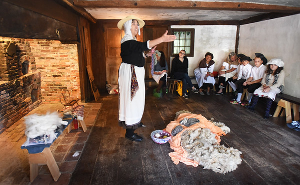 BRYAN EATON/Staff photo. Museum teacher Suzi Brown talks about making from clothing from sheared sheep at the Swett-Ilsley House.