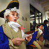 BRYAN EATON/Staff photo. At the push of the red star on his chest George Washington, a.k.a. Marcus Clark,10, rises to give a brief biography of the first president of the United States. The third-graders were studying the Revolutionary War and chose a character from that era to dress up as and give a quick bio at a Wax Museum for parents on Monday afternoon.
