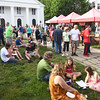 BRYAN EATON/Staff photo. People sat on the lawn of the Main Street Congregational Church in downtown Amesbury eating food from local restaurants and taking in the scene.