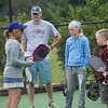 JIM VAIKNORAS/Staff photo Volunteer Sue Carnavale teaches the fundimentals of Pickleball to Ryan Pavao , his daughter Brela, 11, as well as Wyatte, 9,  and Malikai,7, Kugal-Mackay during a demostration of Pickleball Saturday at Perkins Park in Newburyport.