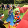 BRYAN EATON/Staff photo. Molin Upper Elementary students play Jungle Gone Wild trying to tip each team's specific animal balloon off the parachute at their Field Day.