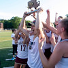 JIM VAIKNORAS/staff photo Newburyport captain Isabelle Sarra holds the Division 2 North Championship trophy at Peabody High School Friday night.. Newburyport defeated Ipswich 15-11