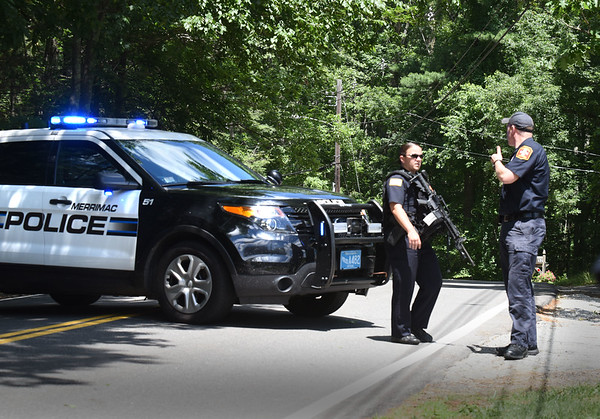 BRYAN EATON/Staff photo. Merrimac police close off Kimball Road in Amesbury as a search for an apparent suicidal person with weapons was underway.