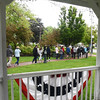 BRYAN EATON/Staff photo. Amesbury Middle School eighth-graders file out of the gazebo in the downtown and head into the libarry after a talk buy Carol Bartlett and Patty Hoyt. They are touring various sites as the learn the history of Amesbury.