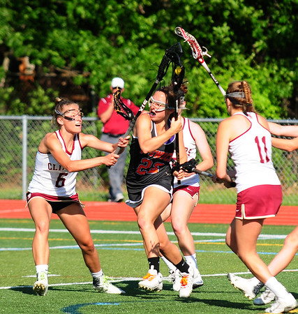 JIM VAIKNORAS/staff photo  Ipswich's Delaney Whooley advances the ball against Newburyport at Peabody High School Friday night. Newburyport defeated Ipswich 15-11 claiming the Div. North Championship.