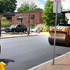 BRYAN EATON/Staff photo. Workers finish the repaving of Harris Street in Newburyport on Friday afternoon.