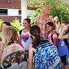 BRYAN EATON/Staff photo. Thursday was the last day of schools for Amesbury student. Amesbury Elementary School principal Walter Helliesen had his photo taken with some fourth-graders who will be attending Amesbury Middle School in the fall.
