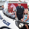 BRYAN EATON/Staff photo. Brenna Currie, 5, of Amesbury tries out Amesbury police officer Jonathan Morrill's motorcycle.