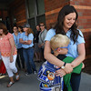 BRYAN EATON/Staff photo. Tim Sheehan, 7, hugs his teacher Chrissy Platt at the Bresnahan School in Newburyport on Wednesday morning as classes let out for the summer.