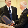 BRYAN EATON/Staff photo. Retiring Amesbury police chief Kevin Ouellet receives congratulations from Mayor Ken Gray.