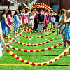 JIM VAIKNORAS/staff photo Newburyport graduates make their way under the Junior Arch of Roses at World War Memorial Stadium Sunday morning.